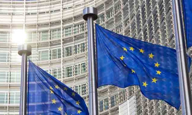 Flags in front of the EU Commission building in Brussels