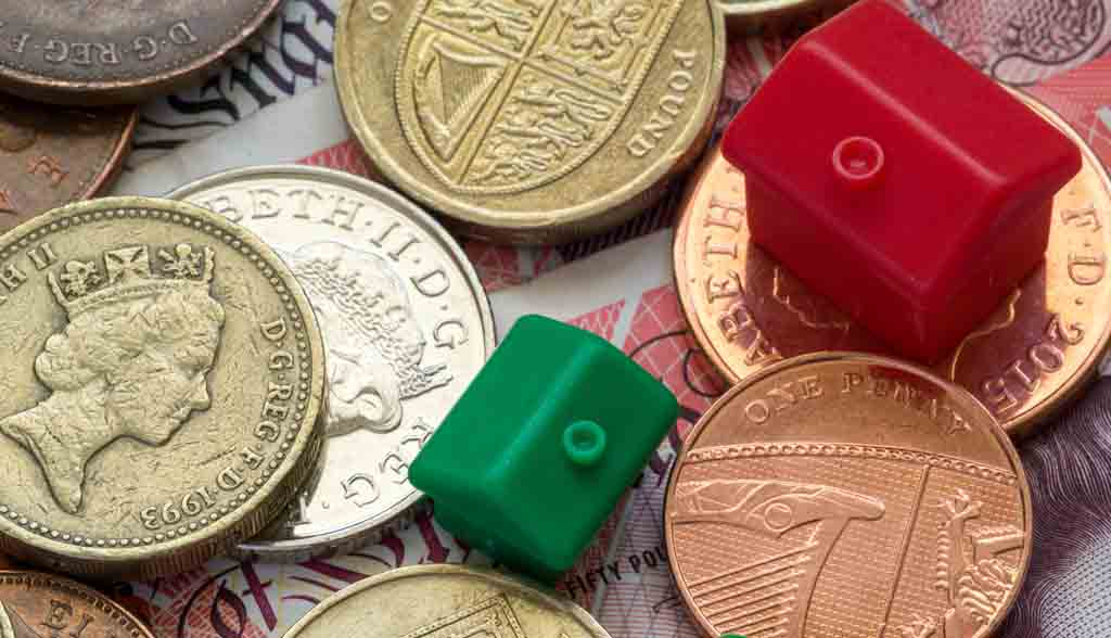 Green and Red Plastic Model Houses and English Coins and Notes
